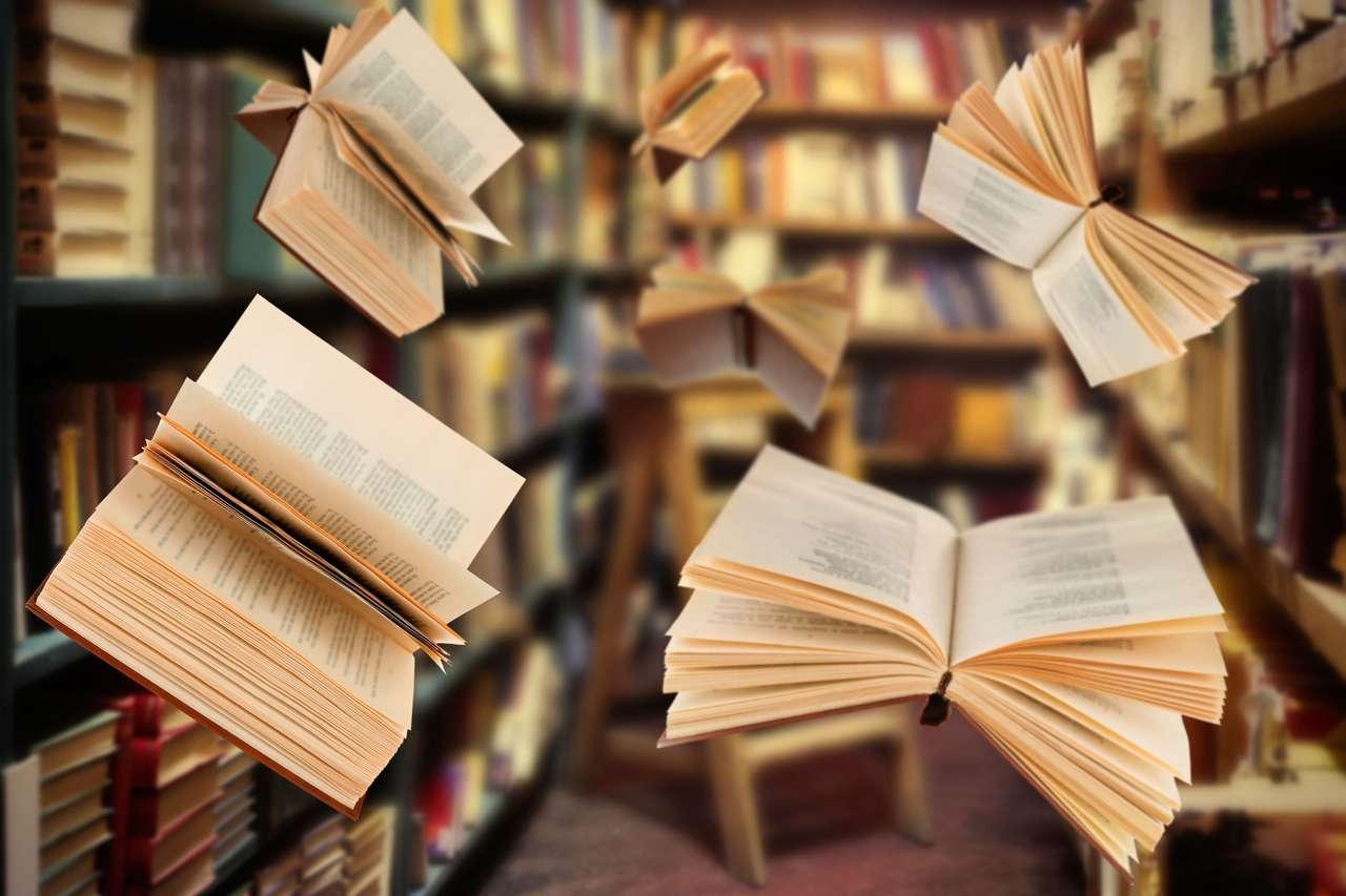 Volare libri aperti in biblioteca